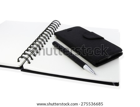 Pen with mobile on notebook