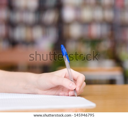 Pen writes in a notebook - stock photo