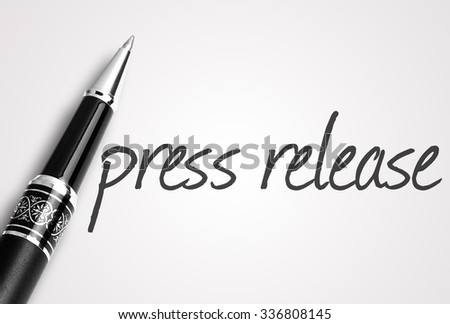 pen writes press release on white blank paper. - stock photo
