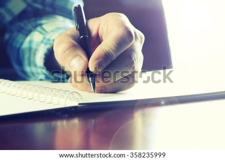 pen writing hand student - stock photo