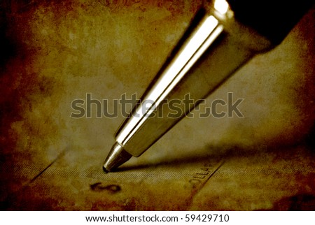 Pen writing on antique check an amount of money - stock photo