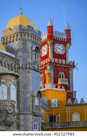 Pena castle red clock tower and blue mosaic towers in Sintra, Portugal
