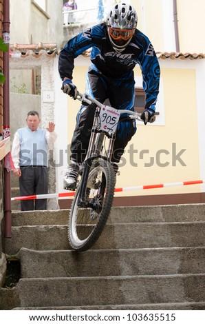 PENACOVA, PORTUGAL - MAY 27: Bruno Tereso during the Taca de Portugal Downhill Urbano Vodafone on may 27, 2012 in Penacova, Portugal. - stock photo