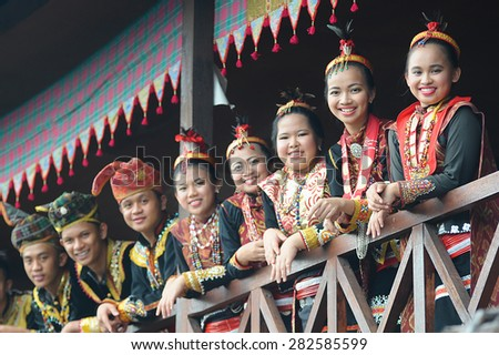Penampang, Sabah Malaysia.May 30, 2015 : A group of people from Lotud tribe of Sabah Malaysian Borneo wearing traditional costume during Pesta Kaamatan.Image with selective focus on the ladies. - stock photo