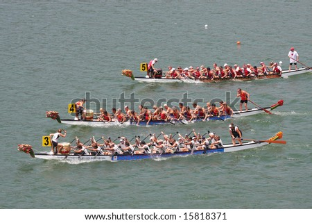 PENANG, MALAYSIA: Dragon boats heading to the finish line in Club Crew World Championships 2008 (Held on 31 July - 3 August 2008 in Penang, Malaysia) - stock photo