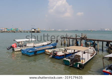 Penang,Malaysia - Jan 1,2015 : Boats at the Chew Jetty which is one of the UNESCO World Heritage Site in Penang.