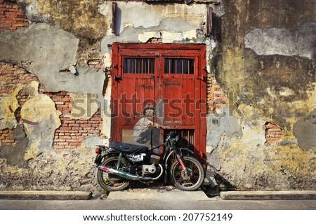PENANG, MALAYSIA-JUL 18, 2014: General view of a mural 'Boy on a Bike'. - stock photo