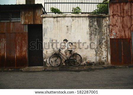 PENANG, MALAYSIA - JUN 15: Street Mural entitled 'LIttle Children on a Bicycle' painted by Ernest Zacharevic in Penang on June 15, 2013.  - stock photo