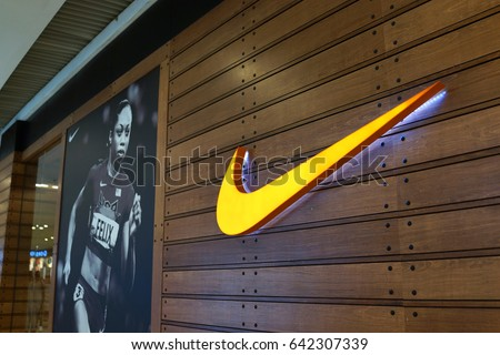 PENANG, MALAYSIA - MAY 12, 2017: Nike store in the Queensbay mall. Nike, Inc. is an American corporation that manufactures and sells footwear, apparel, equipment, accessories and services worldwide.