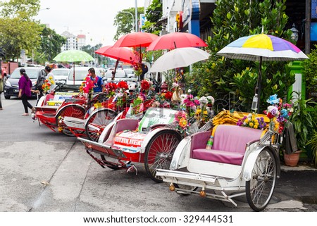 PENANG,MALAYSIA-Sep 5 ,2015: Vintage  Trishaw stop beside road for service traveller in Penang ,Malaysia. - stock photo