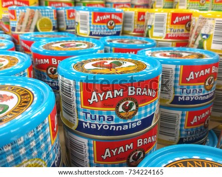 Conservations on white shelves food stock images royalty for Tuna fish brands