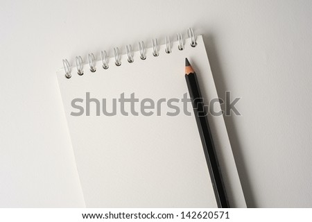 pencil and a blank notebook - blocknote - stock photo