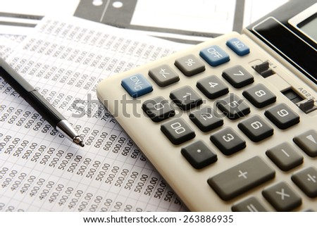 pencil and calculator on plans and sheet number - stock photo