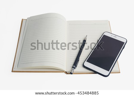 pencil and mobile phone put on close notebook with white background