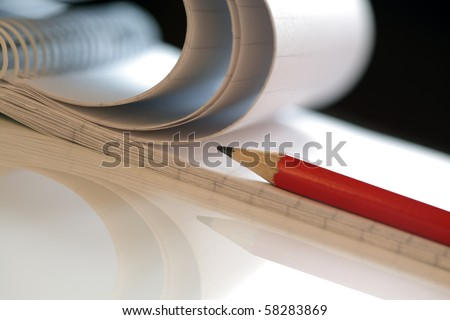 Pencil and note pad on a white desk in a meeting shallow depth of field - stock photo