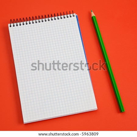 pencil and notebook over a red background - stock photo