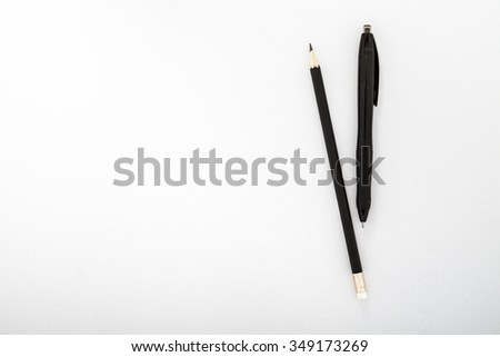 pencil and pen on a white background - stock photo