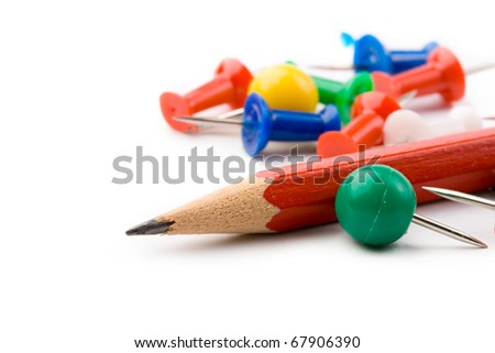 Pencil and pins isolated on white