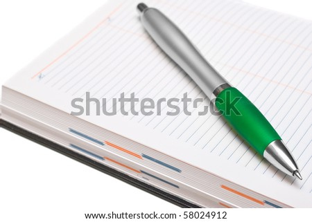 Pencil and Pocket Planner on white background - stock photo