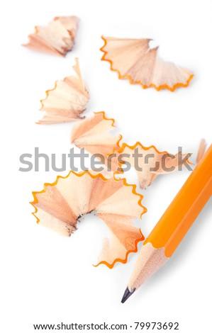 Pencil and shavings over white backrgound - stock photo
