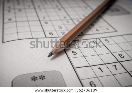 Pencil and sudoku crossword. Puzzle game. - stock photo