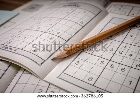 Pencil and sudoku crosswords. - stock photo