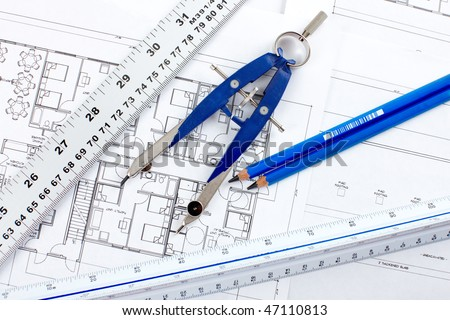 pencil and tools over a construction drawing of a house - stock photo