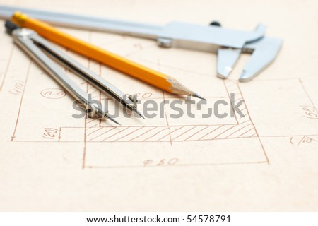 Pencil, caliper and  compasses on Engineer drawing - stock photo