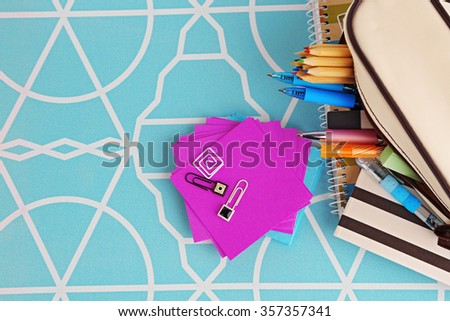 Pencil case with various stationery, close up - stock photo