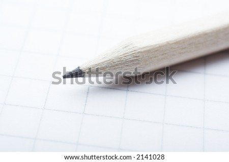 Pencil close up on the cross-ruled paper - stock photo