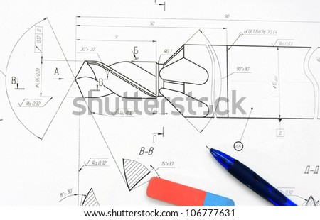 Pencil, eraser on the drawing. - stock photo