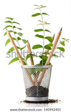 Pencil holder with pencils growing as plants - stock photo
