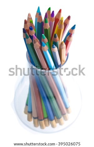 Pencil in glass on white background, photo, lot of colors - stock photo