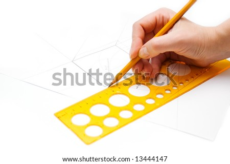 Pencil in hand,drawing a sketch - stock photo
