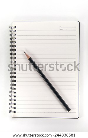 pencil on a notebook - stock photo