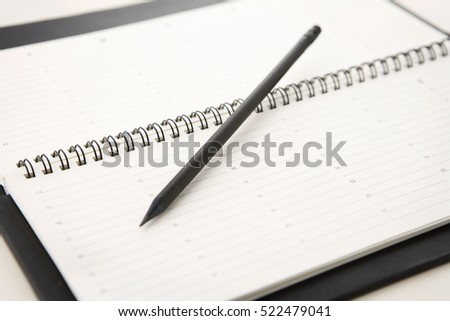 pencil on a notebook