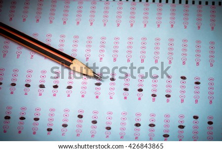 pencil on answer sheet, test score sheet with answers in thai education - stock photo