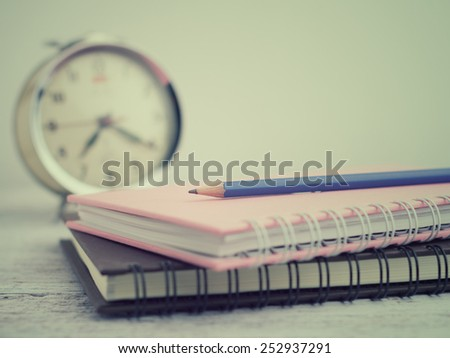 Pencil on book - stock photo