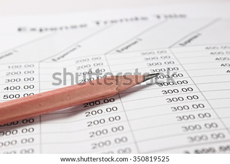 Pencil on business report