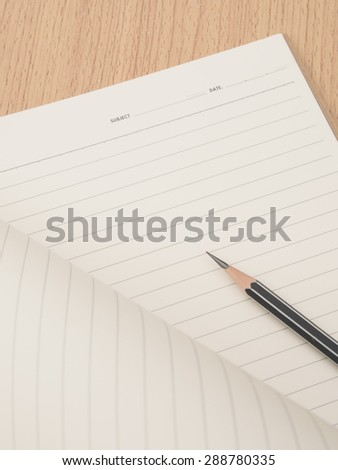 Pencil on ring binding notebook with paper opening, Selective focus on pencil sharpness - stock photo