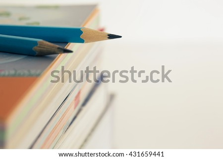 Pencil on stack book with copy space. - stock photo