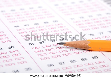 Pencil on test page - stock photo