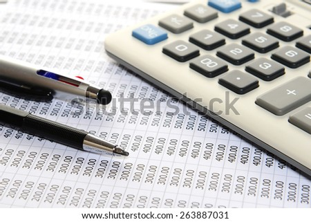pencil, pen and calculator on sheet number - stock photo