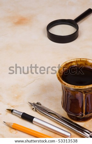 pencil, pen and cup of tea - stock photo