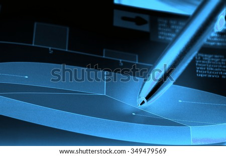 Pencil pointing in cake diagram. Statistics concept. Blue pencil and diagram on black background - stock photo