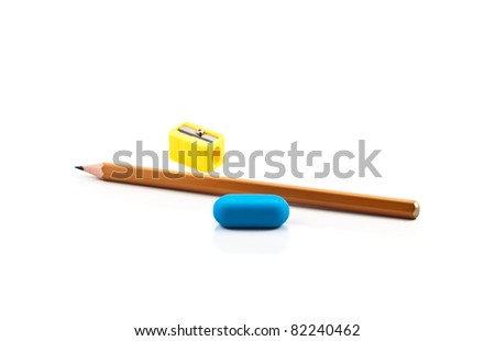 Pencil, sharpener and eraser on the white - stock photo