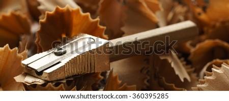 Pencil, sharpener and wood shavings  - banner / header edition - stock photo