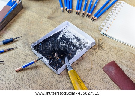 pencil sharpener by cutter knife - stock photo