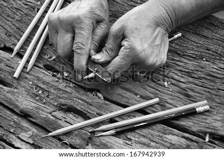pencil sharpener on wood background -  vintage style. - stock photo