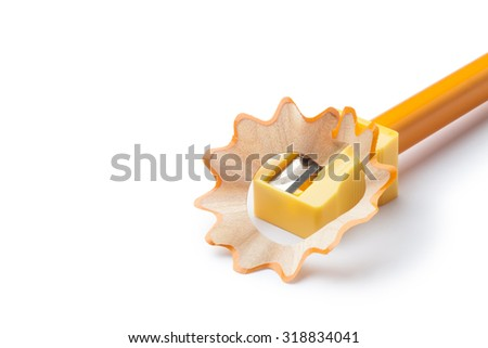 Pencil sharpener with yellow pencil - stock photo